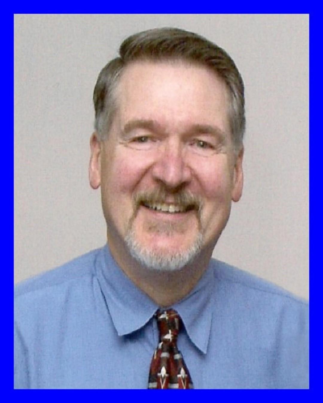 Dr. Earl A. Palmer