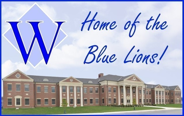 home of the blue lions slogan over building art